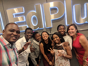 Baobab student interns smile in front of a chrome EdPlus at ASU sign